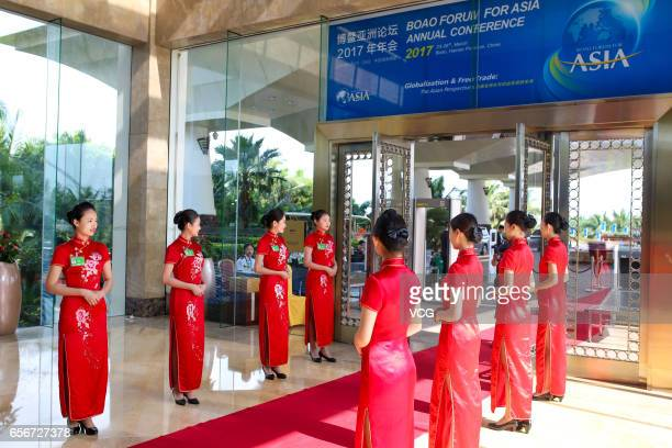 Ritual girls wait for guests before the Boao Forum for Asia Annual Conference 2017 on March 22 2017 in Qionghai Hainan Province of China The Boao...