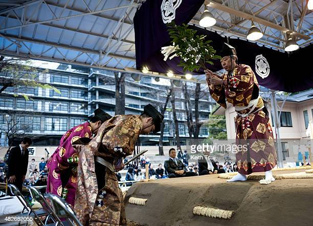 A ritual purification ceremony is performed by the sumo referees during the Ceremonial Sumo Tournament or Honozumo at the Yasukuni Shrine on April 4...