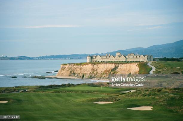 Ritz Carlton Half Moon Bay luxury hotel perched on sea cliffs with Half Moon Bay Golf Links golf course in foreground, Half Moon Bay, California,...
