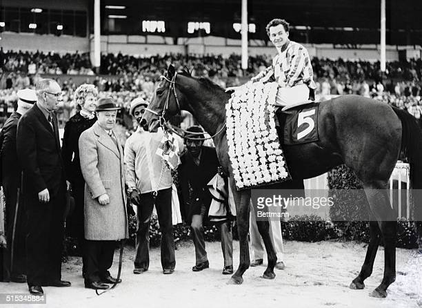 Riva Ridge with jockey Ron Turcotte in the saddle pictured in the winner's circle at Garden State Park after annexing top honors in the $293 Garden...