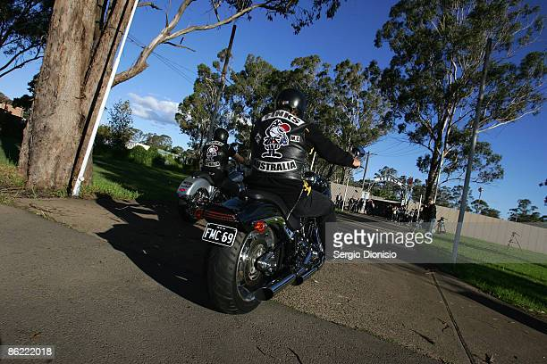 Rival bike club members from the Pink's Bikie gang arrive for a meeting of the NSW Bikers Council during a media call at the Rebel's Clubhouse on...