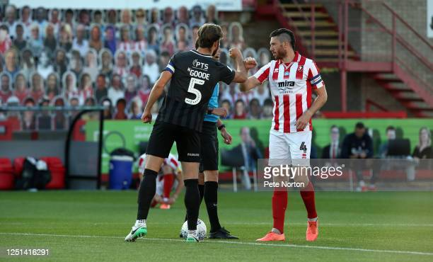 Rival Captains Charlie Goode of Northampton Town and Ben Tozer of Cheltenham Town exchange an arm bump at the coin toss during the Sky Bet League Two...