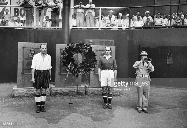 Rival captains from Manchester United FC and Tottenham Hotspur FC place a wreath before memorials to baseball stars Babe Ruth and Lou Gehrig who...