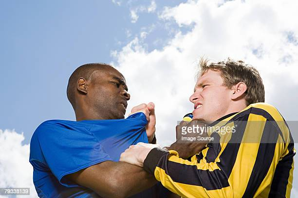 Rival footballers fighting