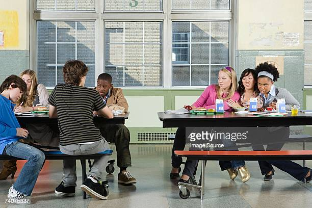 rival groups in the cafeteria - nerd girl stock photos and pictures