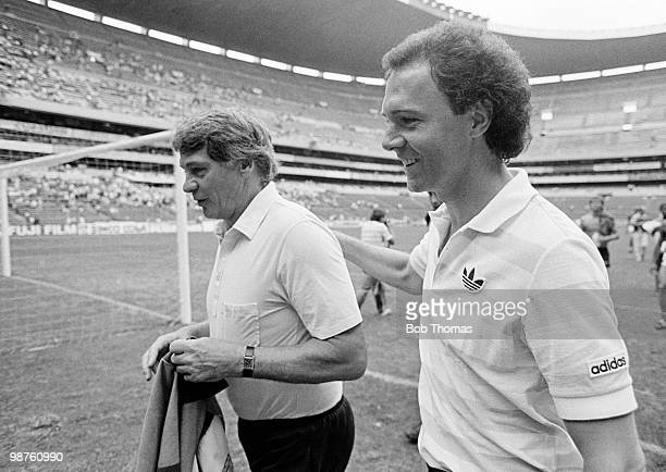 Rival managers Bobby Robson of England and Franz Beckenbauer of West Germany leave the field after the Soccer International match held at the Aztec...