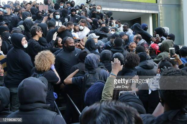 Rival protesters clash as crowds make their way down the steps on the Southbank near Waterloo station on June 13 2020 in London United Kingdom...