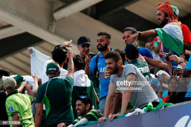 Rival supporters clash during the ICC Champions Trophy final cricket match between India and Pakistan at The Oval in London on June 18 2017...