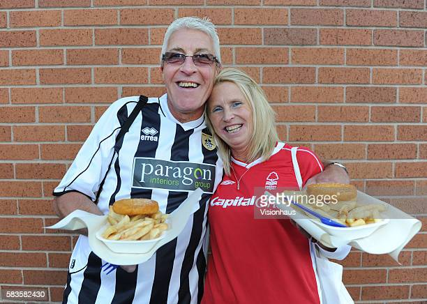 Rival supporters share a bag of chips before the Carling Cup match between Nottingham Forest and Notts County at the City Ground in Nottingham United...