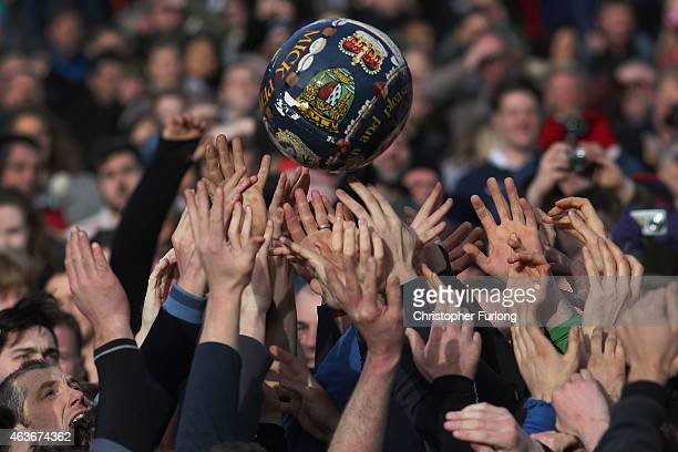 Rival teams the 'Up'ards and Down'ards' battle for the ball during the annual Ashbourne Shrovetide 'no rules' football match on February 17 in...