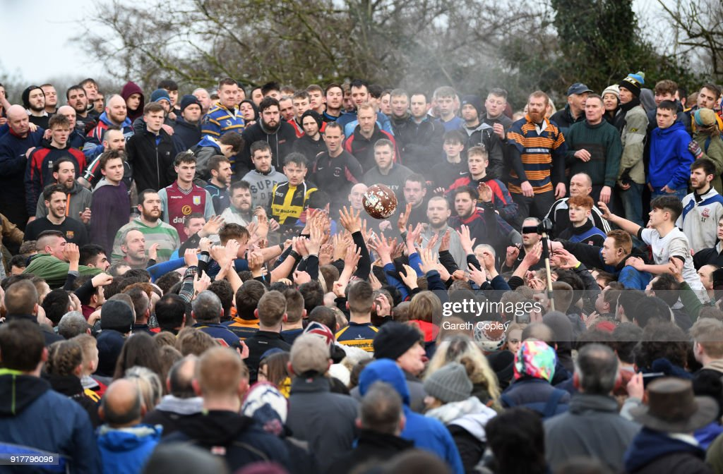 Rival teams 'Up'ards' and 'Down'ards' battle for the ball during the Royal Shrovetide Football match in Ashbourne, Derbyshire, England on February 13, 2018. For two days, over Shrove Tuesday and Ash Wednesday, hundreds of participants battle it out in a 'no rules' game dating back to the 17th Century where the aim is to get a ball into one of two goals that are positioned three miles apart at either end of Ashbourne.