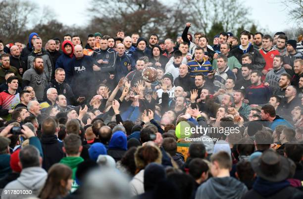 Rival teams 'Up'ards' and 'Down'ards' battle for the ball during the Royal Shrovetide Football match in Ashbourne Derbyshire England on February 13...