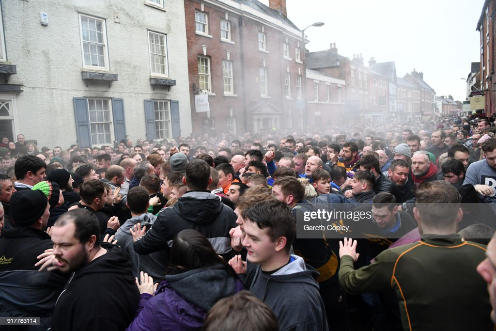 Rival teams 'Up'ards' and 'Down'ards' battle for the ball in the streets during the Royal Shrovetide Football match in Ashbourne, Derbyshire, England on February 13, 2018. For two days, over Shrove Tuesday and Ash Wednesday, hundreds of participants battle it out in a 'no rules' game dating back to the 17th Century where the aim is to get a ball into one of two goals that are positioned three miles apart at either end of Ashbourne.
