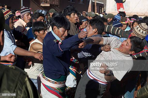 Rival villagers clash in the streets of Macha during the Tinku Festival Macha Bolivia 4th May 2010 Photo Tim Clayton Each May up to 3000 thousands...