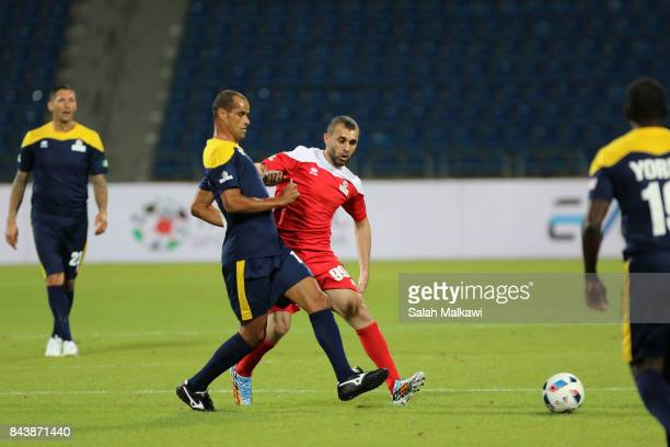 Rivaldo and A Hayel vie for the ball during the friendly football match between World Stars and Jordan Stars on September 7 2017 in Amman Jordan