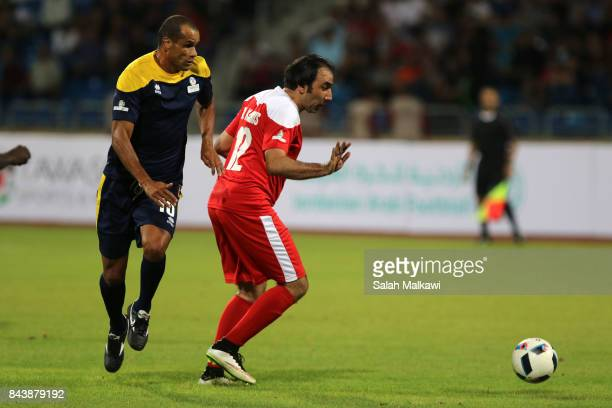 Rivaldo and MKhamis vie for the ball during the friendly football match between World Stars and Jordan Stars on September 7 2017 in Amman Jordan