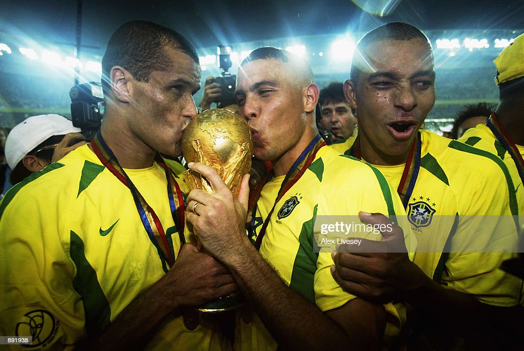Rivaldo and Ronaldo of Brazil kiss the trophy after the Germany v Brazil, World Cup Final match played at the International Stadium Yokohama in Yokohama, Japan on June 30, 2002. Brazil won 2-0.