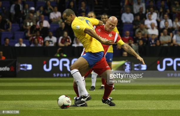 Rivaldo of Brazil and Stig Tofting of Denmark in action during the SemiFinal Star Sixes match between Brazil and Denmark at The O2 Arena on July 16...