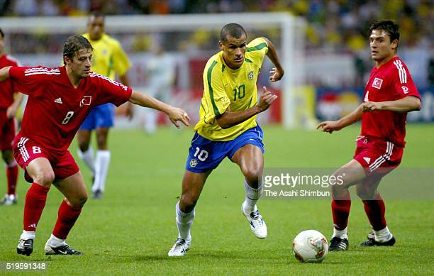 Rivaldo of Brazil and Tugay Kerimoglu of Turkey compete for the ball during the FIFA World Cup Korea/Japan semi final match between Brazil and Turkey...