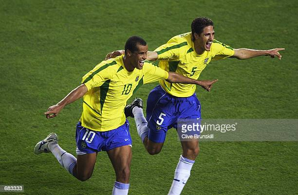Rivaldo of Brazil celebrates scoring a penalty with team mate Edmilson during the Group C match against Turkey at the World Cup Group match played at...