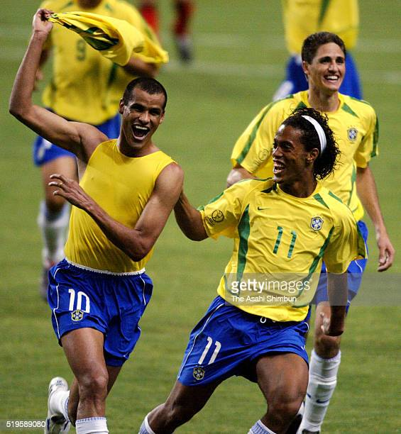 Rivaldo of Brazil celebrates scoring his team's first goal with his team mate Ronaldinho during the FIFA World Cup Korea/Japan round of 16 match...
