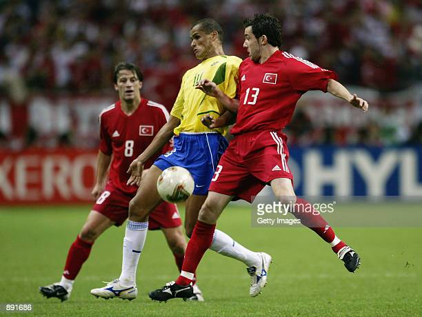 Rivaldo of Brazil finds no way past Muzzy Izzet and Tugay Kerimoglu of Turkey during the FIFA World Cup Finals 2002 SemiFinal match played at the...