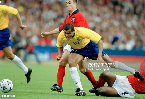 Rivaldo of Brazil is brought down by Dennis Wise of England and Paul Ince during an International Friendly at Wembley Stadium on May 27 2000 in...