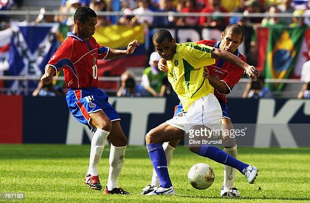 Rivaldo of Brazil is challenged by Luis Marin and Walter Centeno of Costa Rica during the Group C match of the World Cup Group Stage played at the...