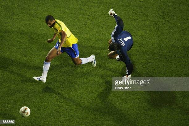 Rivaldo of Brazil slips past the Turkish Goalkeeper Rustu Receber during the Group C match of the World Cup Group Stage played at the Ulsan-Munsu...