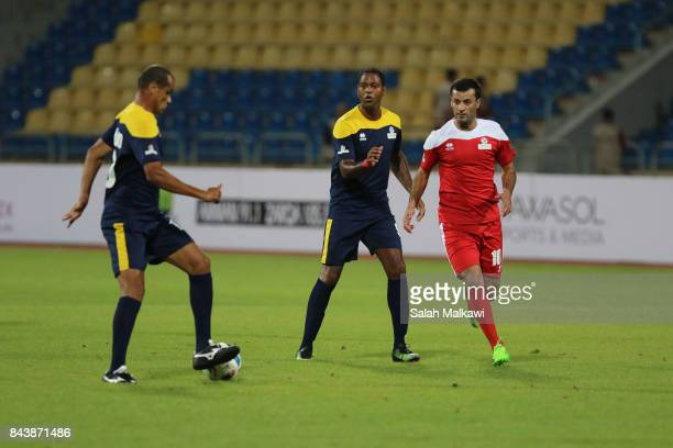 Rivaldo passes to Patrick Cluivert in front of Al Shuaibi during the friendly football match between World Stars and Jordan Stars on September 7 2017...
