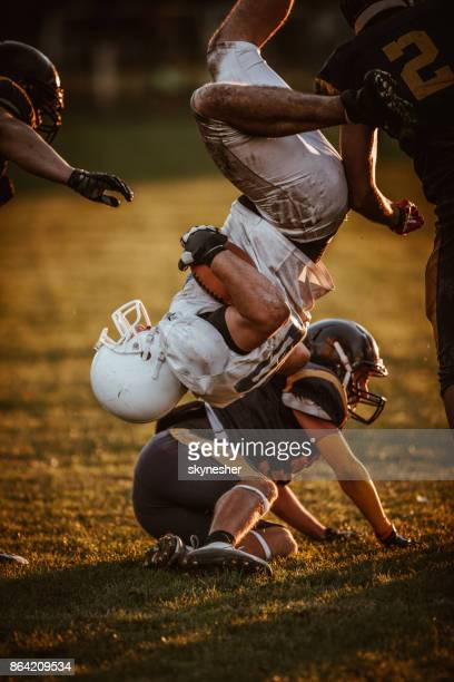 rivalry on american football match! - tackling stock pictures, royalty-free photos & images