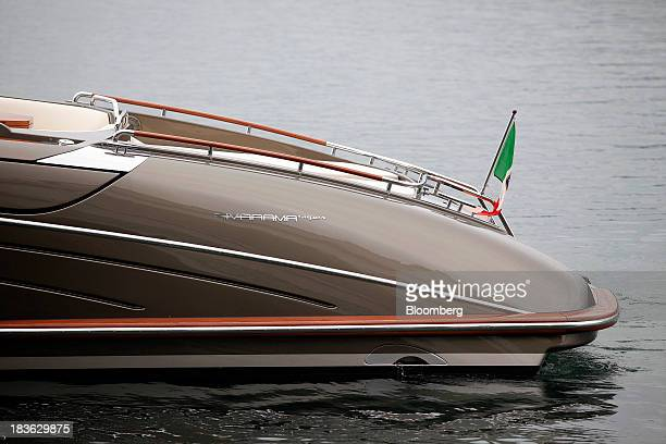 A Rivarama Super logo sits on the hull of a luxury yacht manufactured by Ferretti Group as it prepares to dock at the company's shipyard in Sarnico...