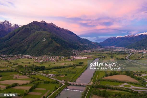 river adda and rhaetian alps, valtellina, italy - terra coltivata foto e immagini stock