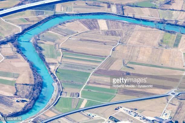 river adda, dubino, lombardy, italy - terra coltivata foto e immagini stock