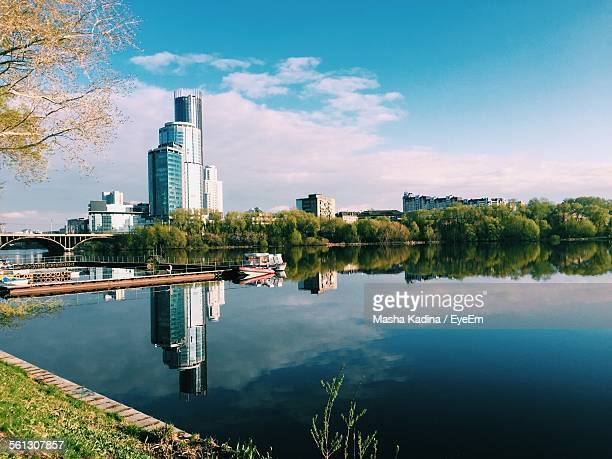 river against buildings and blue sky - yekaterinburg stock pictures, royalty-free photos & images