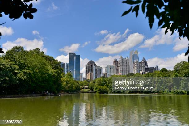 river against buildings in city - piedmont park atlanta georgia stock pictures, royalty-free photos & images