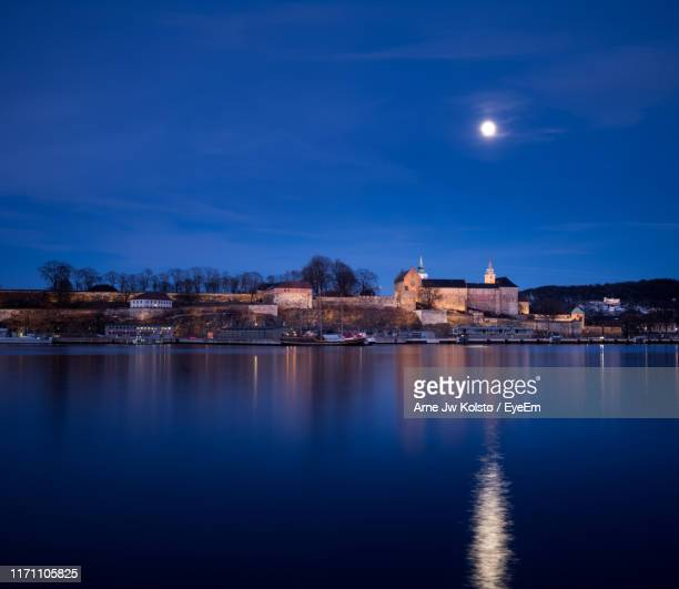 river against sky at night - arne jw kolstø stock pictures, royalty-free photos & images