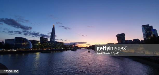 river amidst buildings against sky during sunset - barrie stock pictures, royalty-free photos & images