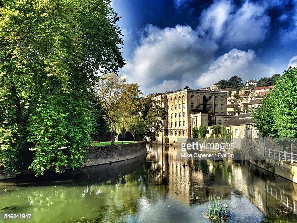 River Amidst Buildings And Tree Against Cloudy Sky In Bradford On Avon