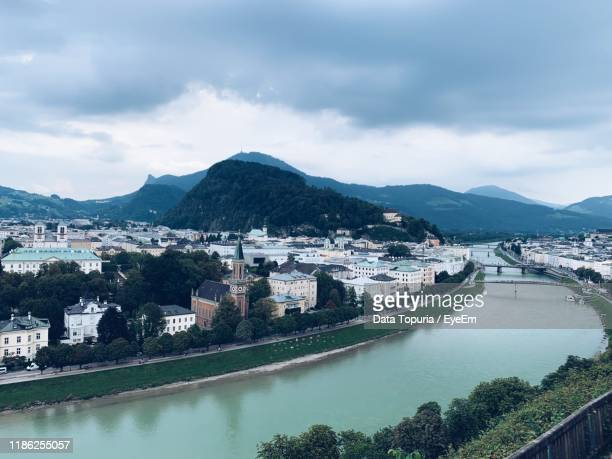 river amidst buildings in city against sky - data topuria stock pictures, royalty-free photos & images