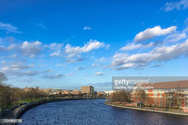river amidst buildings in city against sky - stockton on tees stock pictures, royalty-free photos & images