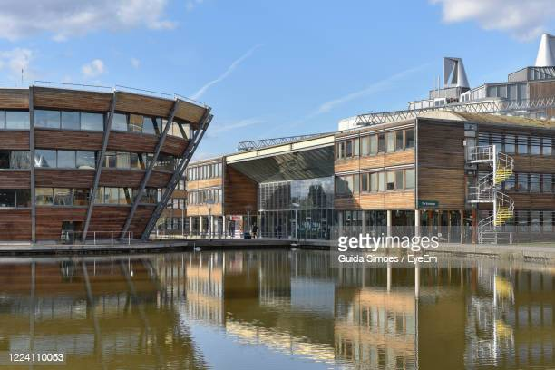 river amidst buildings in city - nottingham stock pictures, royalty-free photos & images
