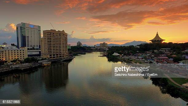 River Amidst City Against Sky During Sunset