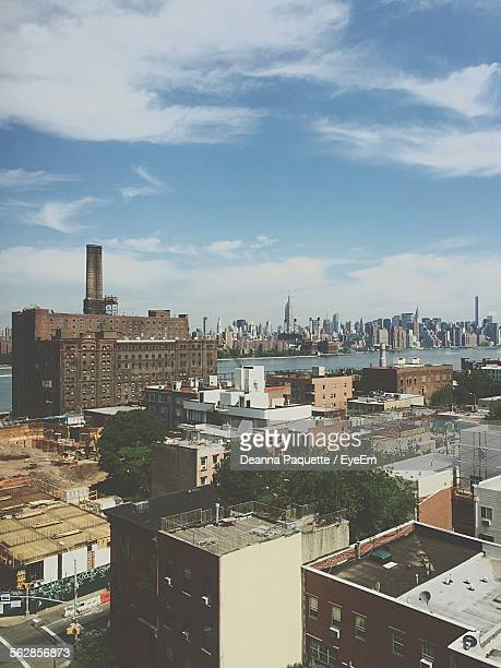 river amidst cityscape against sky - yonkers stock pictures, royalty-free photos & images