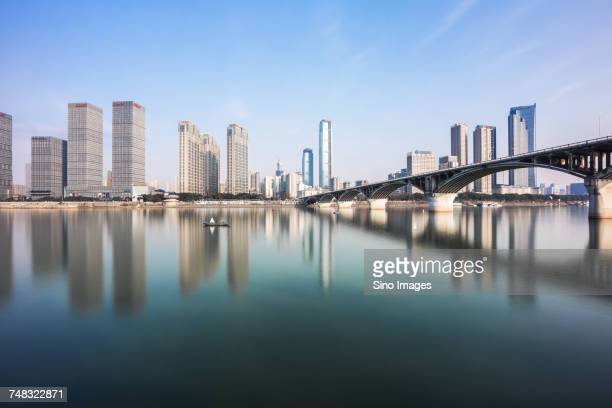 river and arch bridge in front of city skyline, changsha, hunan, china - changsha stock pictures, royalty-free photos & images