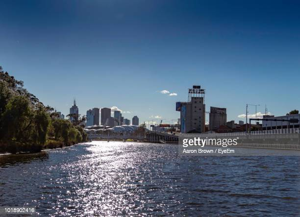 River And Buildings Against Clear Sky
