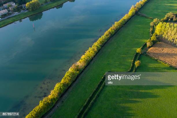 river and fields at dusk, aerial view - bush stock pictures, royalty-free photos & images