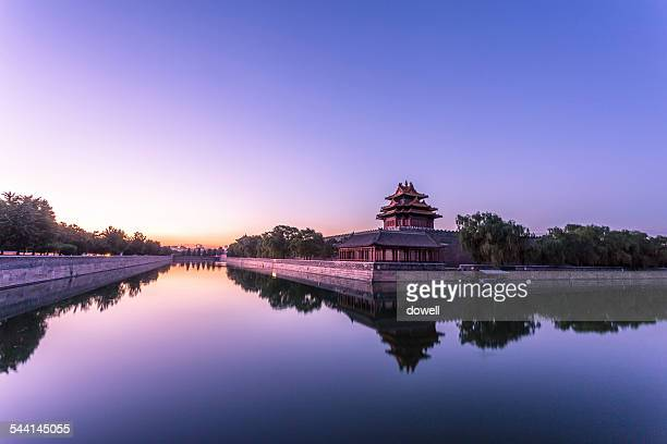 river and forbidden city in beijing at sunset