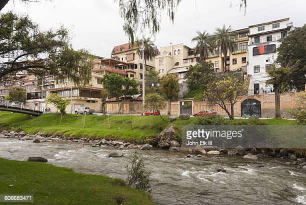 River and homes in Cuenca, Ecuador