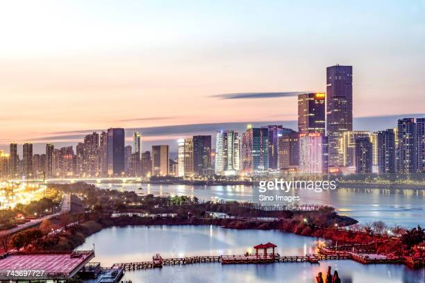 River and skyscrapers in city of Fuzhou at sunset, Fujian, China